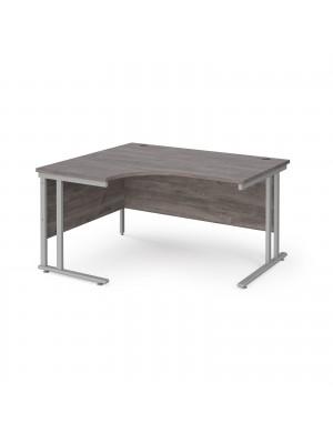 Maestro 25 left hand ergonomic desk 1400mm wide - silver cantilever leg frame, grey oak top