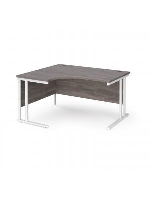 Maestro 25 left hand ergonomic desk 1400mm wide - white cantilever leg frame, grey oak top